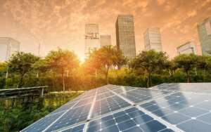 Solar panels in a sunrise.